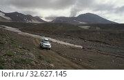Купить «SUV Toyota Land Cruiser Prado driving on mountain road in direction of travel destinations for mountain climbing», видеоролик № 32627145, снято 16 августа 2019 г. (c) А. А. Пирагис / Фотобанк Лори