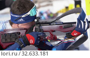 Купить «Sportsman biathlete rifle shooting, aiming, reloading rifle in prone position. Biathlete Amirbekov Artem in shooting range. Junior biathlon competitions East of Cup», видеоролик № 32633181, снято 14 апреля 2019 г. (c) А. А. Пирагис / Фотобанк Лори