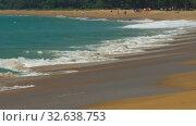 Купить «The tourist on sand beach at Mai Khao beach near Phuket airport», видеоролик № 32638753, снято 8 декабря 2019 г. (c) Игорь Жоров / Фотобанк Лори