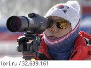 Купить «Coach of South Korea biathlon team watches biathletes in monocle at shooting range of biathlon arena. Junior biathlon competitions East of Cup», фото № 32639161, снято 14 апреля 2019 г. (c) А. А. Пирагис / Фотобанк Лори