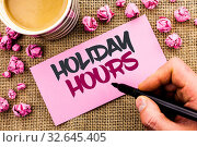 Купить «Conceptual hand writing showing Holiday Hours. Business photo text Celebration Time Seasonal Midnight Sales Extra-Time Opening written by Man Holding Marker Paper the jute background Cup», фото № 32645405, снято 9 апреля 2020 г. (c) easy Fotostock / Фотобанк Лори