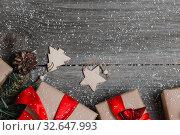 Купить «Christmas Presents Decor On Wooden Table Background», фото № 32647993, снято 3 ноября 2019 г. (c) Иван Карпов / Фотобанк Лори