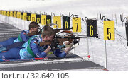 Купить «Sportsman biathlete aiming, rifle shooting, reloading rifle in prone position. Biathlete Smolyakov Danila in shooting range. Junior biathlon competitions East of Cup», видеоролик № 32649105, снято 14 апреля 2019 г. (c) А. А. Пирагис / Фотобанк Лори