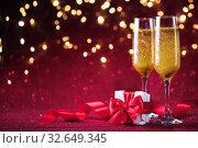 Champagne and valentines day decoration on red glitter background. Стоковое фото, фотограф Евдокимов Максим / Фотобанк Лори