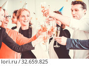 Business people celebrating 2018 New Year at office party. Стоковое фото, фотограф Zoonar.com/Tatiana Badaeva / easy Fotostock / Фотобанк Лори