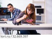 Two technicians working at computer warranty center. Стоковое фото, фотограф Elnur / Фотобанк Лори