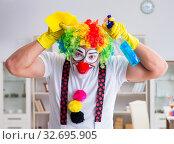 Купить «Funny clown doing cleaning at home», фото № 32695905, снято 12 мая 2017 г. (c) Elnur / Фотобанк Лори