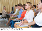 Купить «Side view of student group with female teacher on lecture», фото № 32696085, снято 8 июля 2020 г. (c) Яков Филимонов / Фотобанк Лори