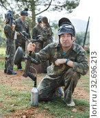 Купить «Paintball player in camouflage with gun», фото № 32696213, снято 22 сентября 2018 г. (c) Яков Филимонов / Фотобанк Лори