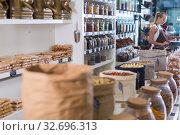 Купить «Illustration of showcase with dried fruits and nuts in bag», фото № 32696313, снято 4 сентября 2017 г. (c) Яков Филимонов / Фотобанк Лори
