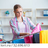Tired depressed housewife doing laundry. Стоковое фото, фотограф Elnur / Фотобанк Лори