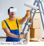 Купить «Painter contractor working with virtual reality goggles», фото № 32696797, снято 23 мая 2017 г. (c) Elnur / Фотобанк Лори