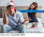 Young happy family celebrating christmas in ed. Стоковое фото, фотограф Elnur / Фотобанк Лори