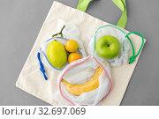Купить «reusable shopping bags for food with fruits», фото № 32697069, снято 3 мая 2019 г. (c) Syda Productions / Фотобанк Лори