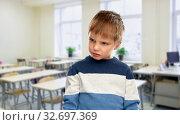Купить «portrait of gloomy little boy at school», фото № 32697369, снято 28 сентября 2019 г. (c) Syda Productions / Фотобанк Лори