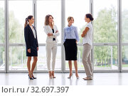 Купить «businesswomen meeting at office and talking», фото № 32697397, снято 3 июля 2016 г. (c) Syda Productions / Фотобанк Лори