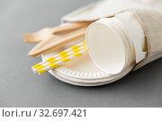 Купить «wooden forks, knives, paper straws and cups», фото № 32697421, снято 3 мая 2019 г. (c) Syda Productions / Фотобанк Лори
