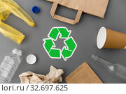 Купить «green recycle symbol with household waste on grey», фото № 32697625, снято 3 мая 2019 г. (c) Syda Productions / Фотобанк Лори
