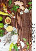 Купить «Top view of organic natural fresh healthy food on wooden background with copy space», фото № 32707617, снято 7 июня 2020 г. (c) easy Fotostock / Фотобанк Лори