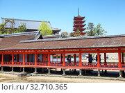 Купить «Red builds and passages is against five-storied Japanese Pagoda Gojunoto are in Itsukushima. Miyajima the Shrine Island lies within Setonaikai National Park», фото № 32710365, снято 13 апреля 2013 г. (c) Кекяляйнен Андрей / Фотобанк Лори