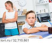 Купить «Portrait of boy who is offended by his sister», фото № 32710861, снято 7 августа 2017 г. (c) Яков Филимонов / Фотобанк Лори