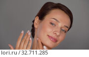 Купить «beautiful young woman touching her face», видеоролик № 32711285, снято 8 декабря 2019 г. (c) Syda Productions / Фотобанк Лори