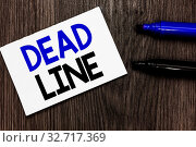 Text sign showing Dead Line. Conceptual photo Period of time by which something must be finished or accomplished Important idea ideas notebook marker markers wooden background reminder. Стоковое фото, фотограф Zoonar.com/Artur Szczybylo / easy Fotostock / Фотобанк Лори