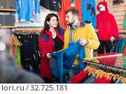 Купить «Couple choosing jacket in store», фото № 32725181, снято 8 марта 2017 г. (c) Яков Филимонов / Фотобанк Лори