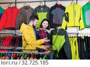 Купить «Couple examining windcheaters in store», фото № 32725185, снято 8 марта 2017 г. (c) Яков Филимонов / Фотобанк Лори