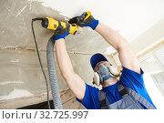concrete ceiling surface grinding by angle grinder machine. Стоковое фото, фотограф Дмитрий Калиновский / Фотобанк Лори