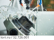 Купить «CNC milling machine work. Coolant and lubrication in gear metalwork industry», фото № 32726001, снято 25 мая 2016 г. (c) Дмитрий Калиновский / Фотобанк Лори