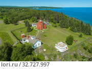 Купить «The Two Harbors Light Station is the oldest operating lighthouse in the US state of Minnesota. Overlooking Lake Superior's Agate Bay, the Light Station is located in Two Harbors, Minnesota.», фото № 32727997, снято 30 июля 2019 г. (c) age Fotostock / Фотобанк Лори