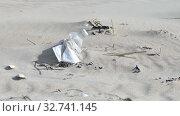 Купить «Plastic foil pollution in beach sand», видеоролик № 32741145, снято 20 декабря 2019 г. (c) Ints VIkmanis / Фотобанк Лори