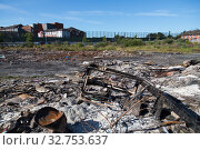 Great Britain, Northern Ireland, Belfast - Protestant part of West Belfast - neglected, burnt square after the bonfire of Orangemens Day, behind the Peace Wall (2019 год). Редакционное фото, агентство Caro Photoagency / Фотобанк Лори