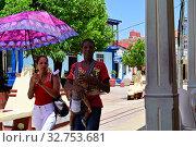 Купить «Cuba, Baracoa-Cuban family on the road in the city centre», фото № 32753681, снято 4 августа 2019 г. (c) Caro Photoagency / Фотобанк Лори