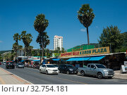 Купить «Phuket, Thailand, road traffic along Karon Plaza at Karon Beach», фото № 32754181, снято 16 ноября 2019 г. (c) Caro Photoagency / Фотобанк Лори