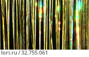 Gold rain from tinsel. Dynamic background in shining lights and sparkling particles. Beautiful gold background with shiny yellow glitter sparkles. Festive mood. Christmas or holiday theme. Стоковое видео, видеограф Dmitry Domashenko / Фотобанк Лори