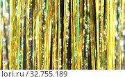 Купить «Gold rain from tinsel on yellow bokeh background. Beautiful dynamic background in shining lights and sparkling particles. Festive mood. Christmas or holiday theme», видеоролик № 32755189, снято 16 февраля 2020 г. (c) Dmitry Domashenko / Фотобанк Лори