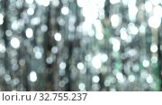 Abstract shiny background with silver defocused bokeh. Beautiful dynamic background in shining lights and sparkling particles. Festive mood. Christmas or holiday theme. Стоковое видео, видеограф Dmitry Domashenko / Фотобанк Лори