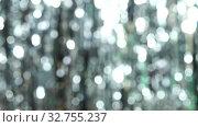 Купить «Abstract shiny background with silver defocused bokeh. Beautiful dynamic background in shining lights and sparkling particles. Festive mood. Christmas or holiday theme», видеоролик № 32755237, снято 10 июля 2020 г. (c) Dmitry Domashenko / Фотобанк Лори