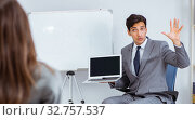 Купить «Business presentation in the office with man and woman», фото № 32757537, снято 7 августа 2017 г. (c) Elnur / Фотобанк Лори