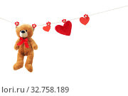 Купить «Teddy bear with red heart isolated on white background. Valentine's day concept», фото № 32758189, снято 13 декабря 2019 г. (c) Майя Крученкова / Фотобанк Лори