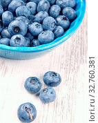 Купить «Fresh blueberries in a rustic blue bowl on a wooden table toned in vintage colors», фото № 32760381, снято 6 июня 2020 г. (c) easy Fotostock / Фотобанк Лори