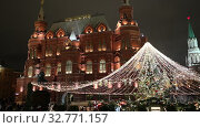Купить «Christmas (New Year holidays) decoration in Moscow (at night), Russia-- Manege Square near the Kremlin», видеоролик № 32771157, снято 24 декабря 2019 г. (c) Владимир Журавлев / Фотобанк Лори