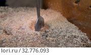 Instrument drilling hole in wooden surface. Стоковое видео, видеограф Ekaterina Demidova / Фотобанк Лори