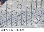 Купить «Фрагмент металлического забора», эксклюзивное фото № 32776469, снято 10 марта 2011 г. (c) lana1501 / Фотобанк Лори