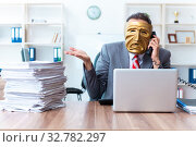 Купить «Businessman wearing mask in hypocrisy concept», фото № 32782297, снято 24 июня 2019 г. (c) Elnur / Фотобанк Лори