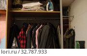 Clothing and iron in wardrobe. Стоковое видео, видеограф Ekaterina Demidova / Фотобанк Лори