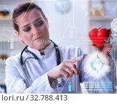 The woman doctor in telemedicine cardiology concept. Стоковое фото, фотограф Elnur / Фотобанк Лори