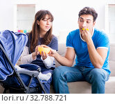 Купить «Young parents with their newborn baby in baby pram sitting on th», фото № 32788721, снято 22 ноября 2017 г. (c) Elnur / Фотобанк Лори